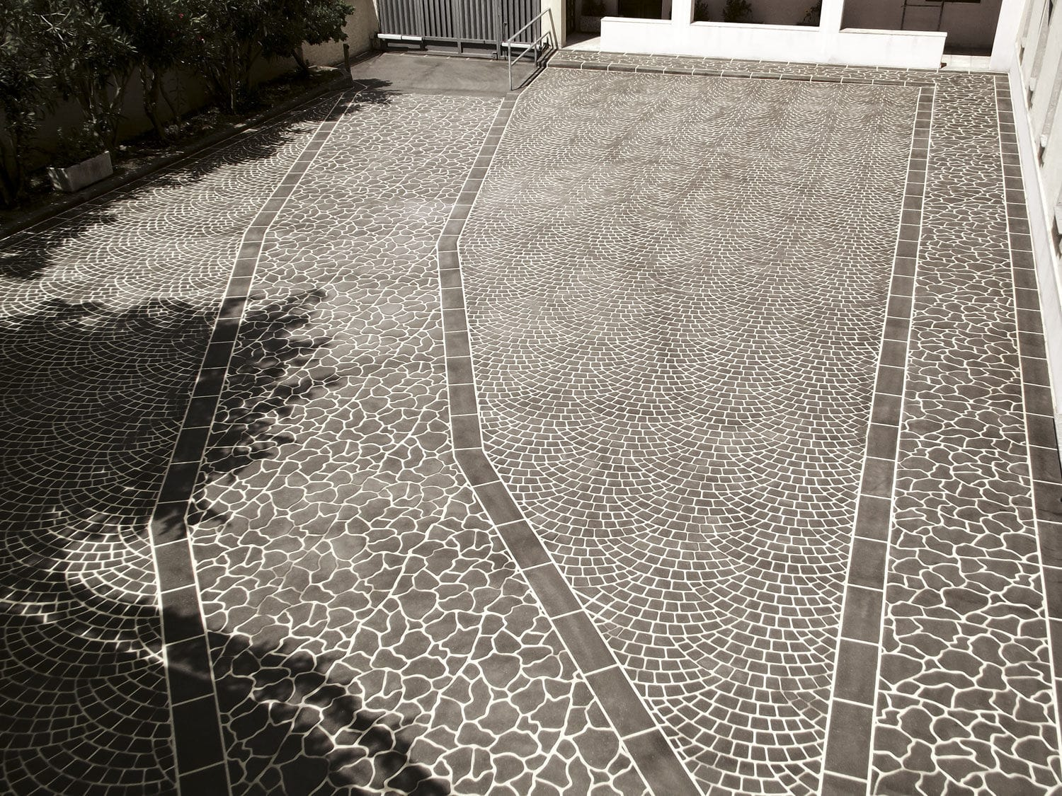 Stamped concrete floor covering / tertiary / textured / paver look