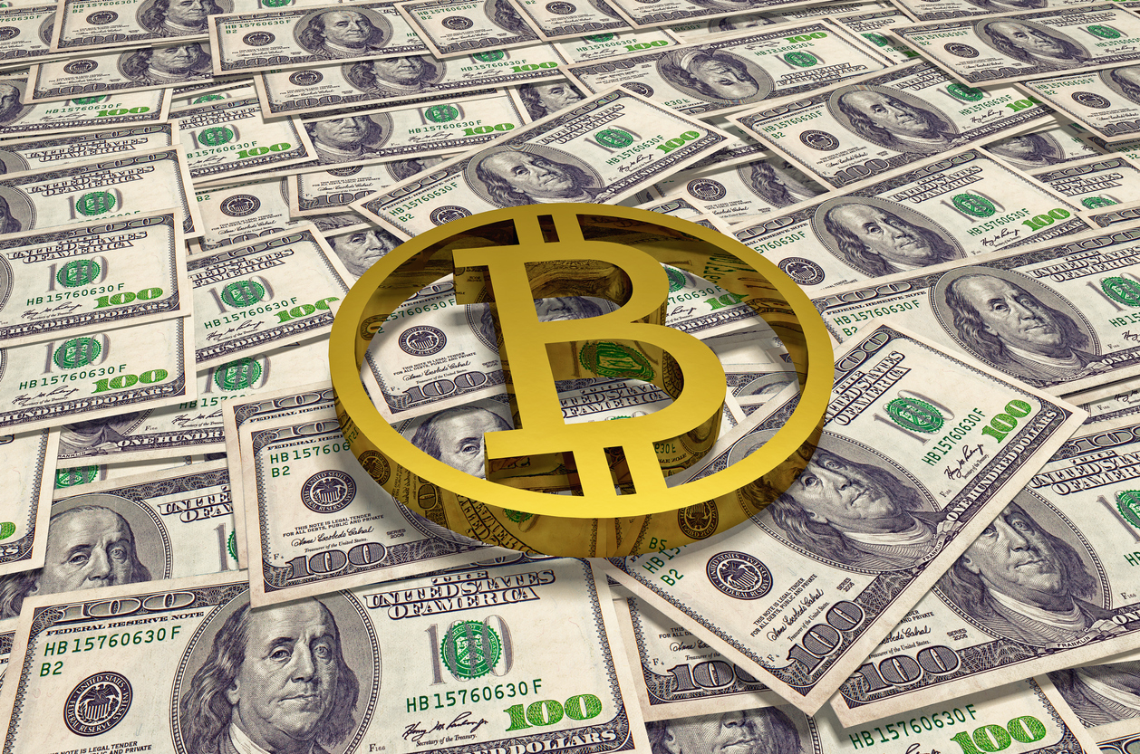 Gold bitcoin coin on background of hundred dollar banknotes on table. High quality 3D render