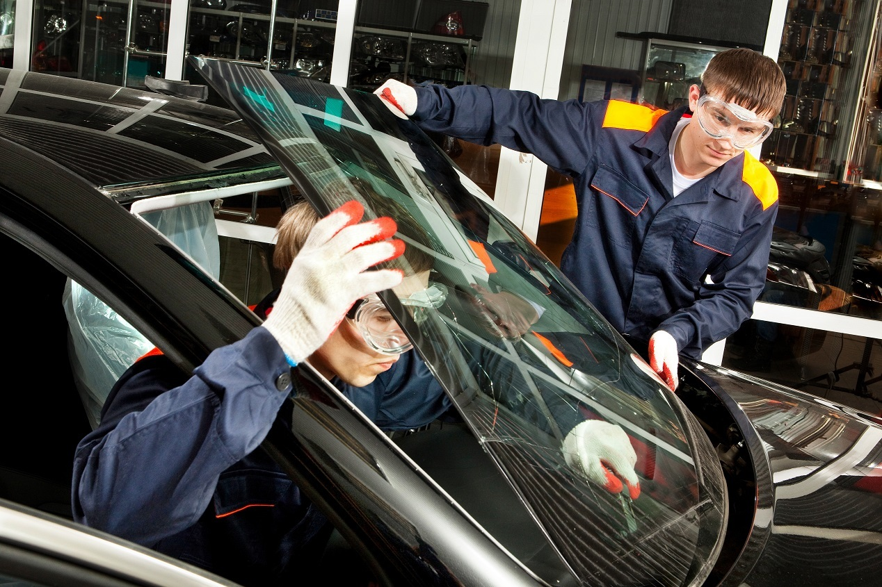 Two Real Mechanics working in Auto Repair Shop